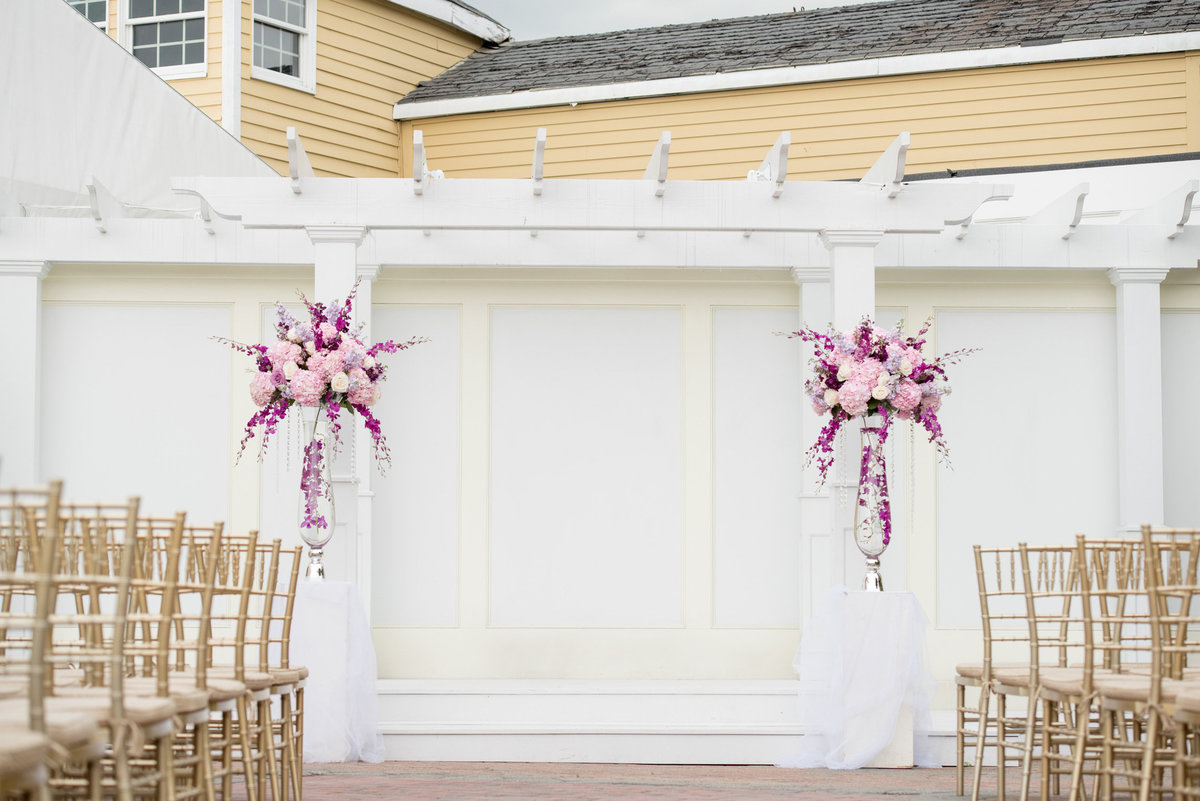 ceremony decor of purple flowers at Bridgeview Yacht Club
