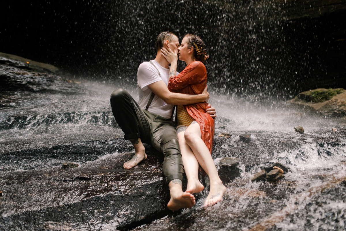 engagement photos in a waterfall