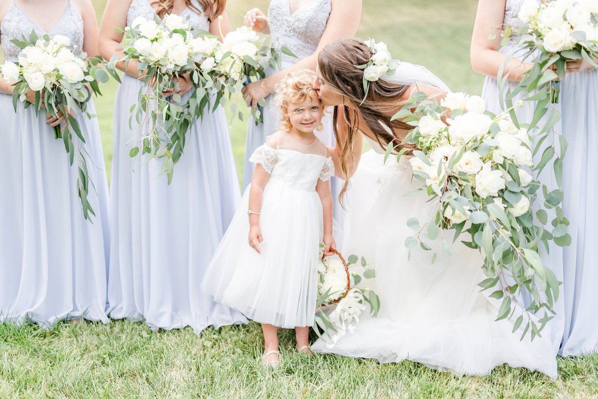 bride-kissing-the-flower-girl