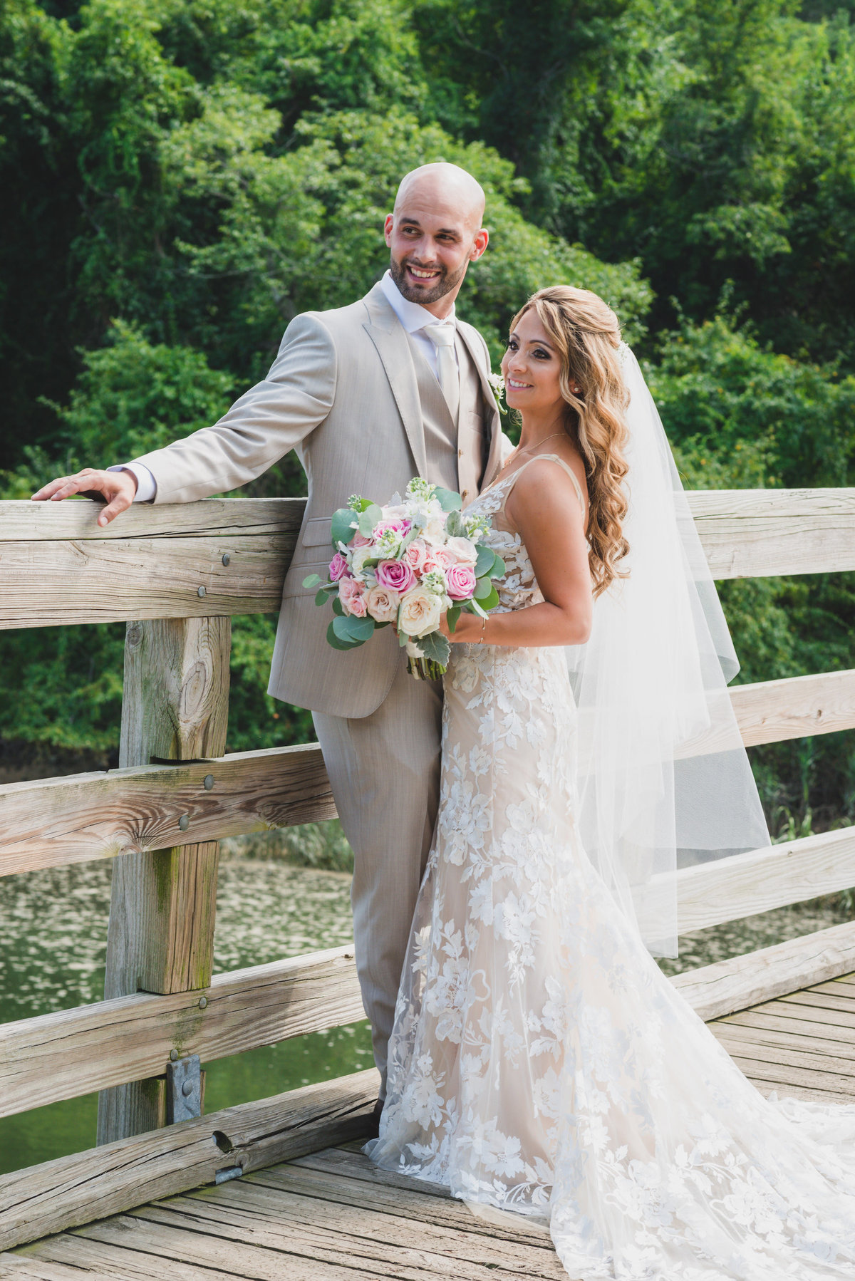 photo of bride and groom on the bridge from beach wedding agt Pavilion at Sunken Meadow