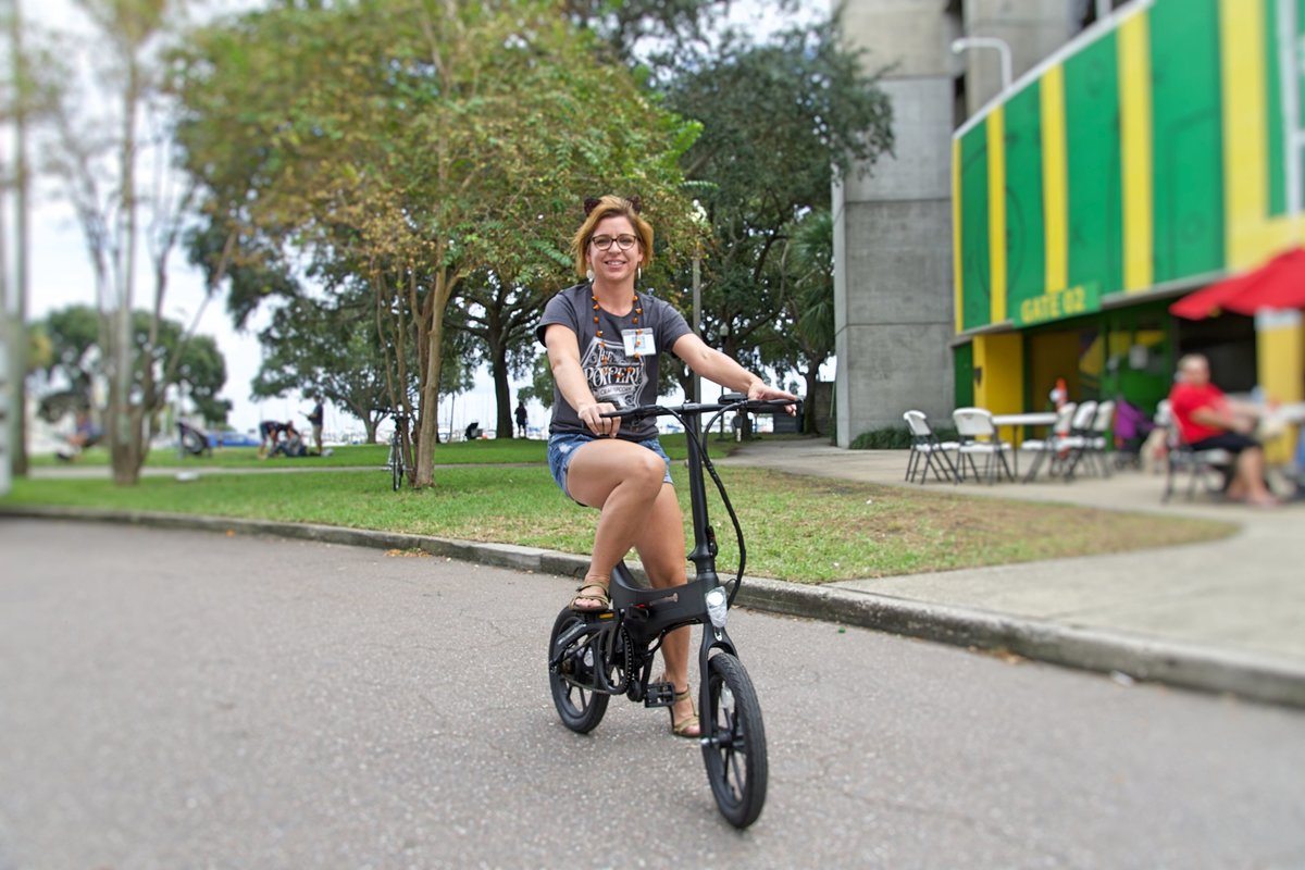 Lady riding Black Go-Bike M4