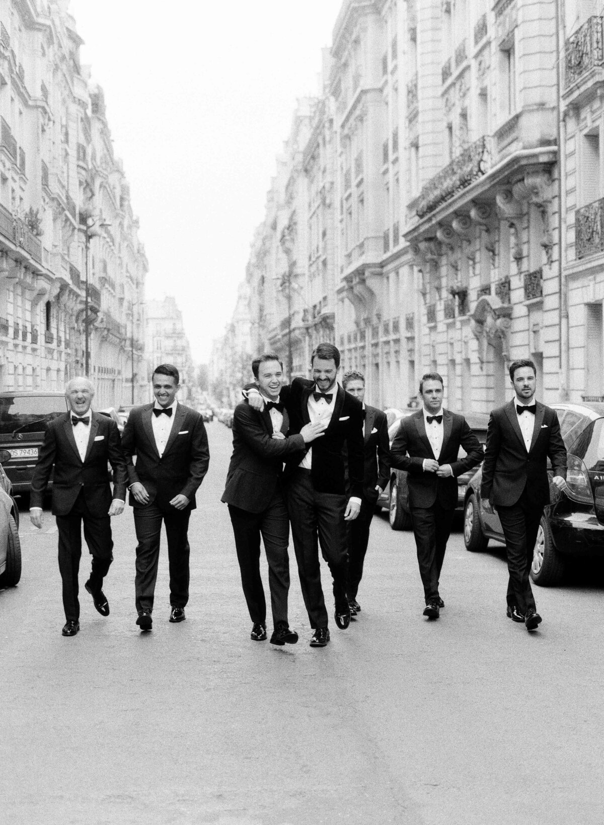 groom with groomsman wearing  blackt ie in Paris