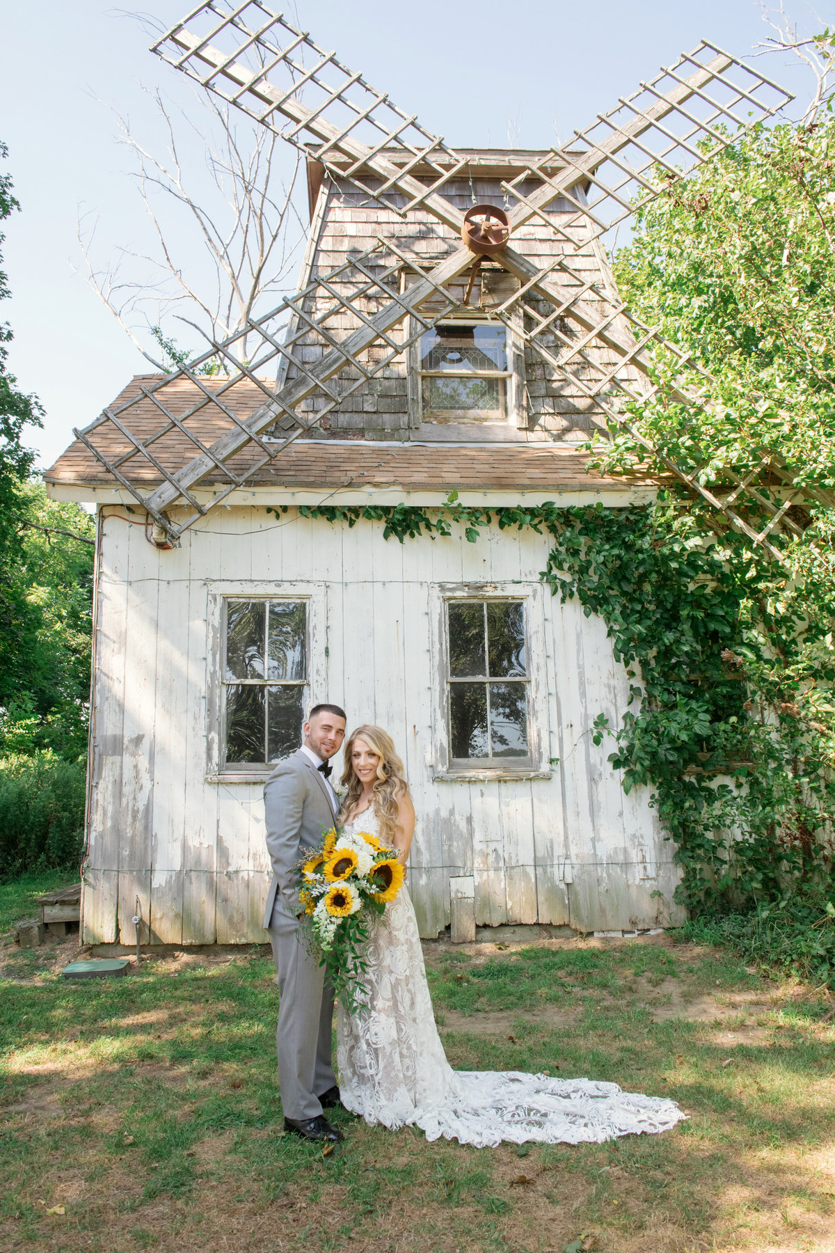 bride and groom in front of windmill at Giorgios Baiting Hollow