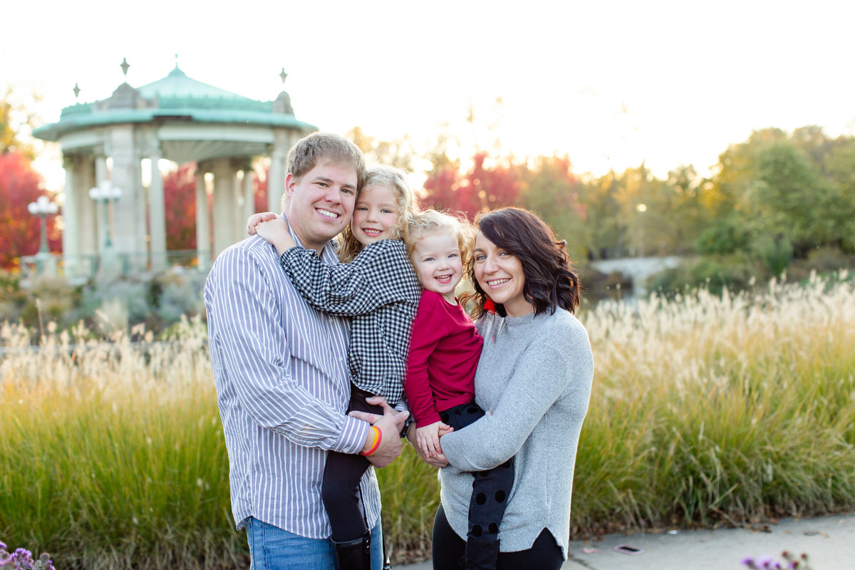 Fall Sunset Family Session with purple flowers and tall grass at Pagoda Circle in Forest Park in St. Louis by Amy Britton Photography Photographer  in St. Louis