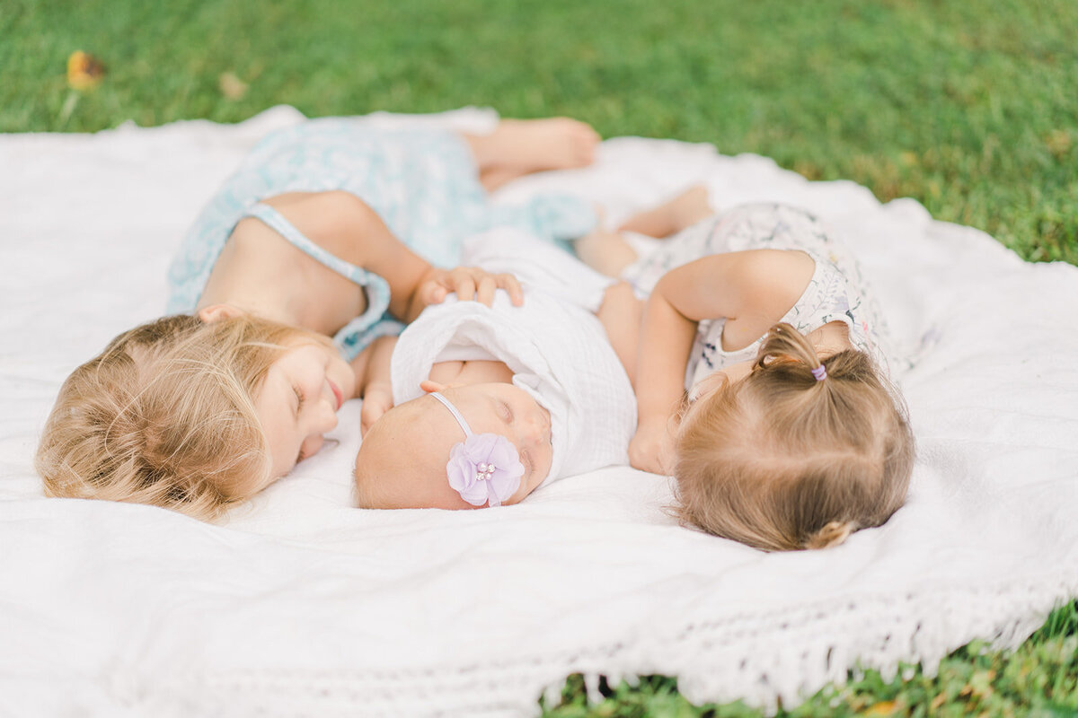 outdoor daughters and newborn baby
