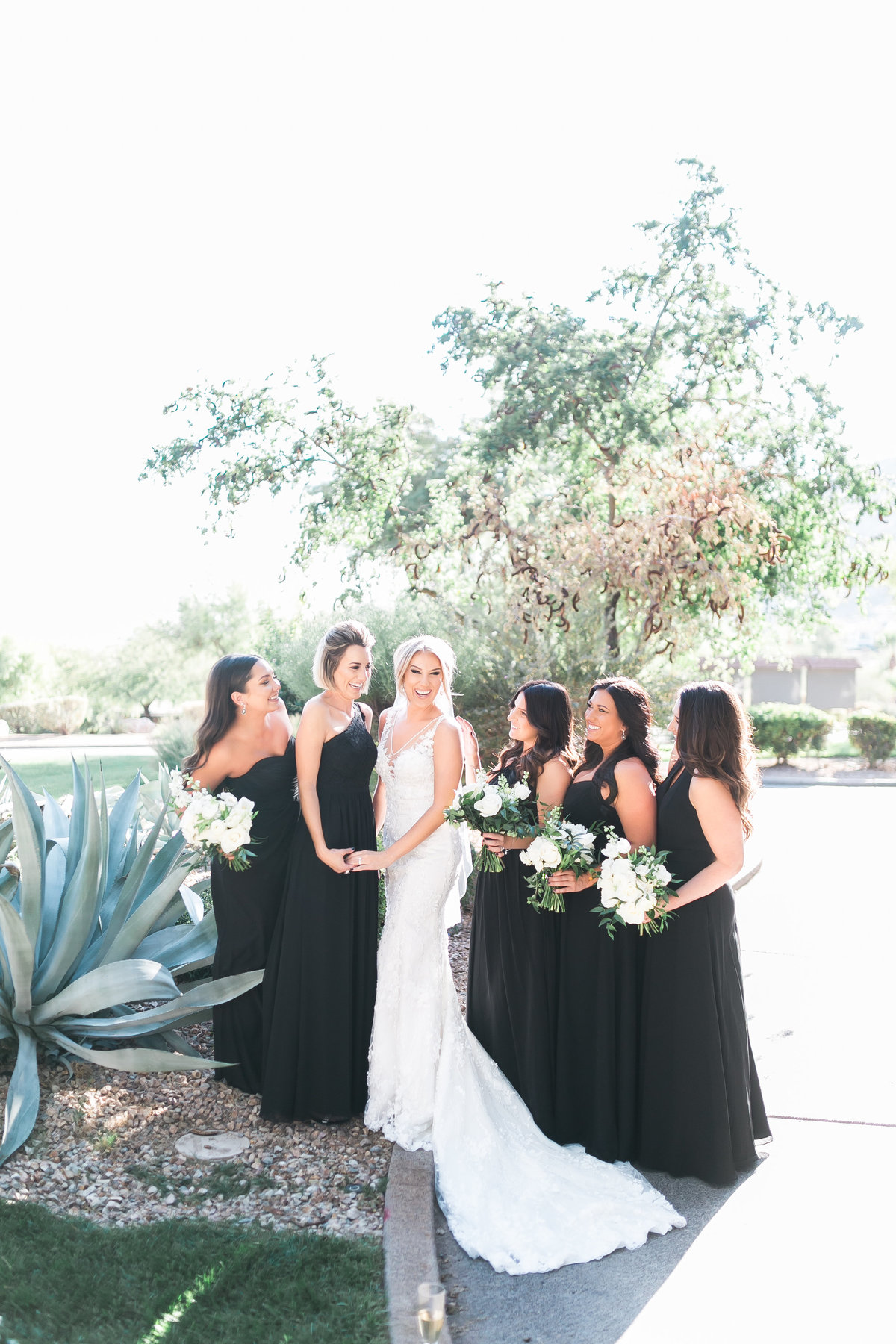 bride and bridesmaids with black bridesmaids dresses at Red Rock Country Club Las Vegas