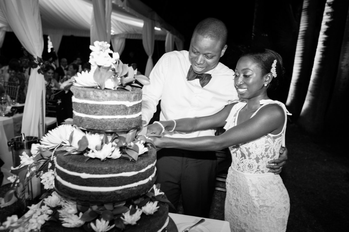 Bride and groom wedding cake cutting at Barbados wedding