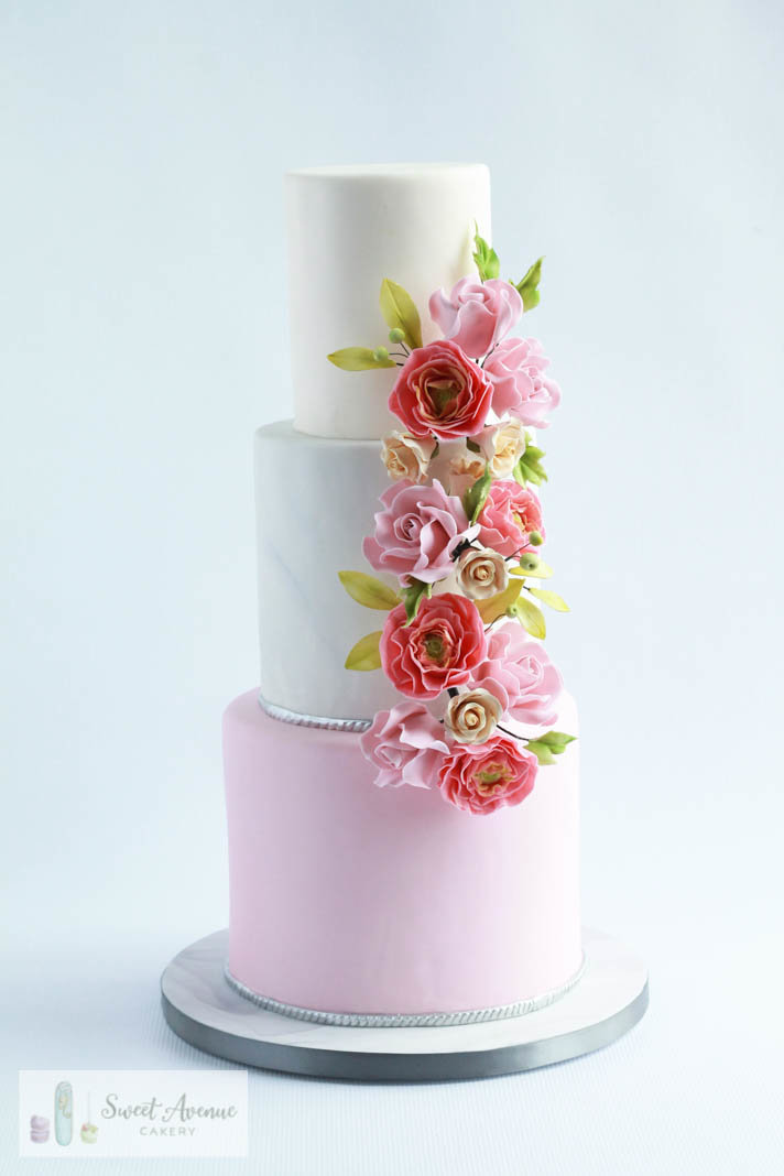 marble and blush wedding cake with sugar flower garland