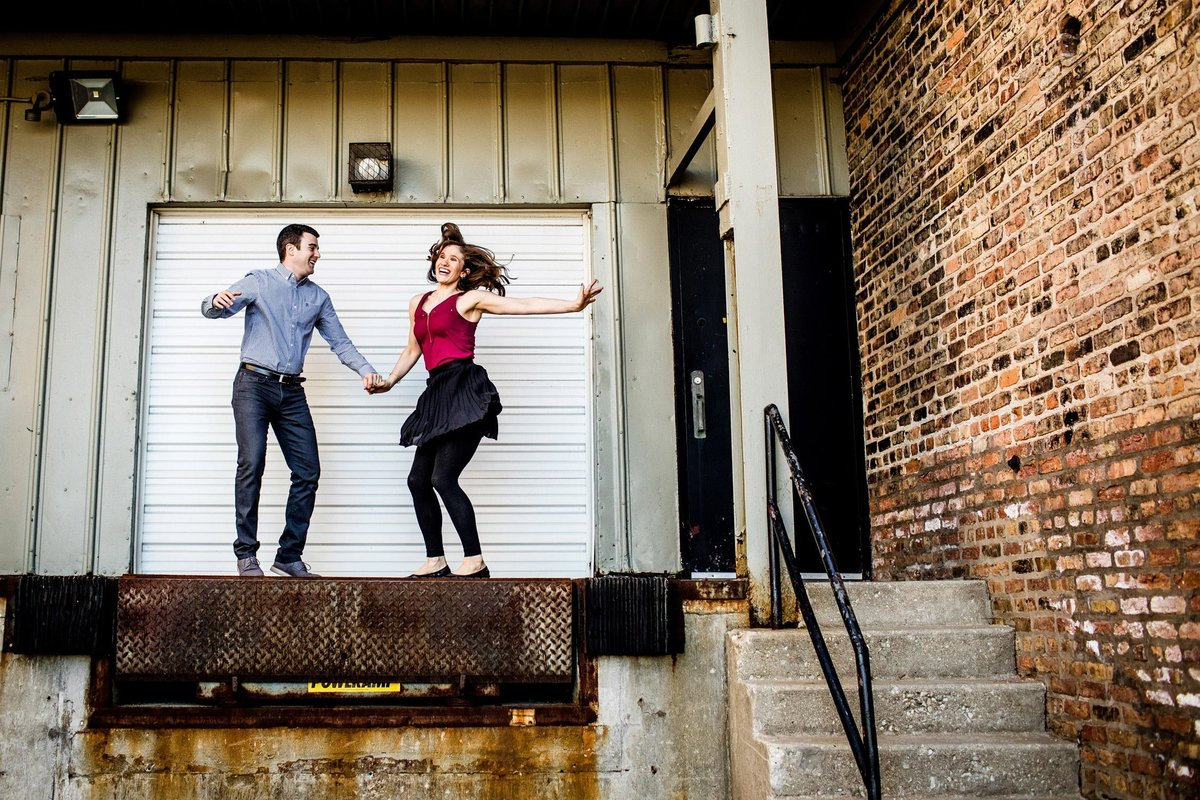 A couple dances together during a West Loop engagement session.