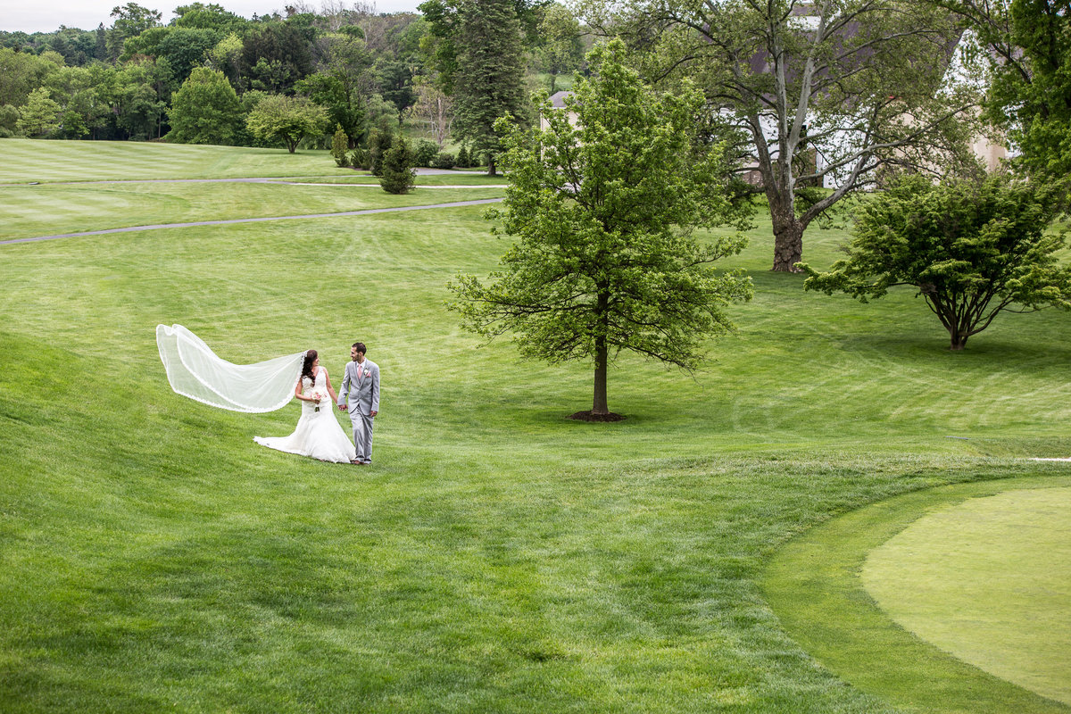 Bride and groom on the golf course