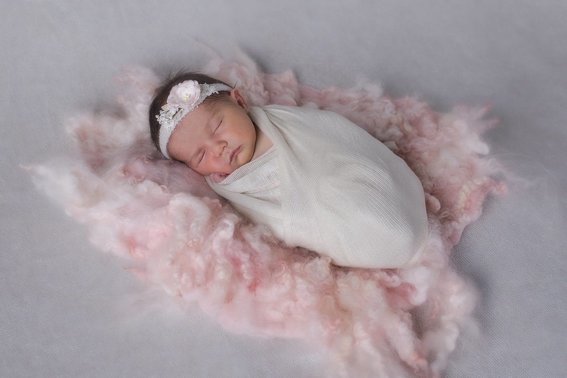 photo of newborn girl on blanket