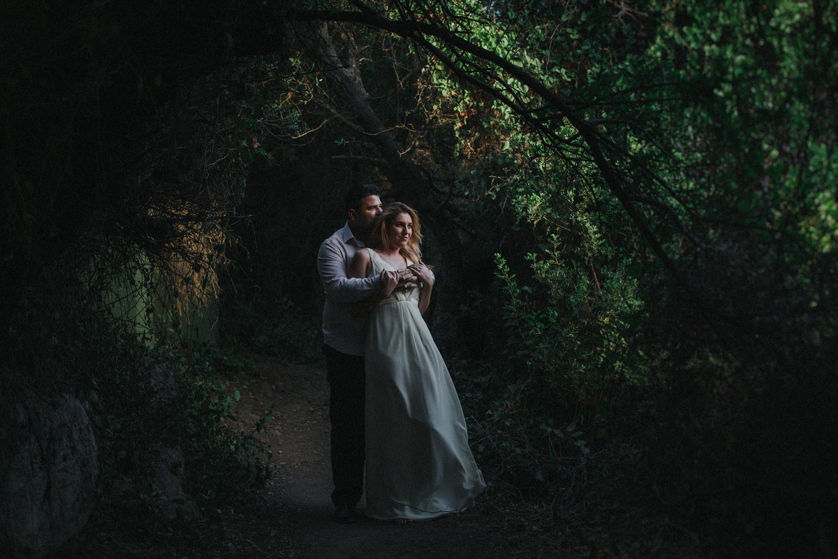 Gibraltar Wedding Photographer Jono Symonds captures groom and his new wife stood embracing looking out over a view in wooded area on 'The Rock', Gibraltar