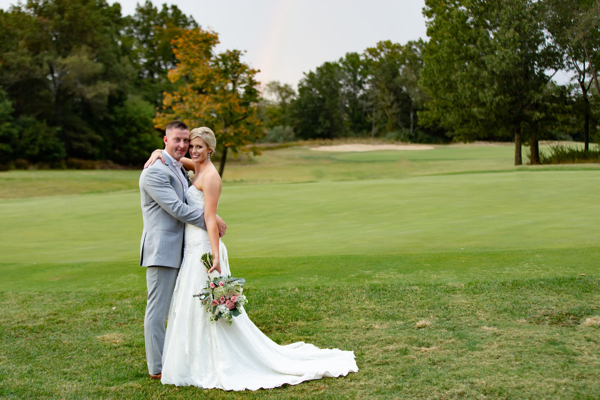 Romantic Fall Elopement  bride and groom photo  with Rainbow at Kokopelli Golf Club  in Southern Illinois  by Amy Britton Photography Photographer in St. Louis