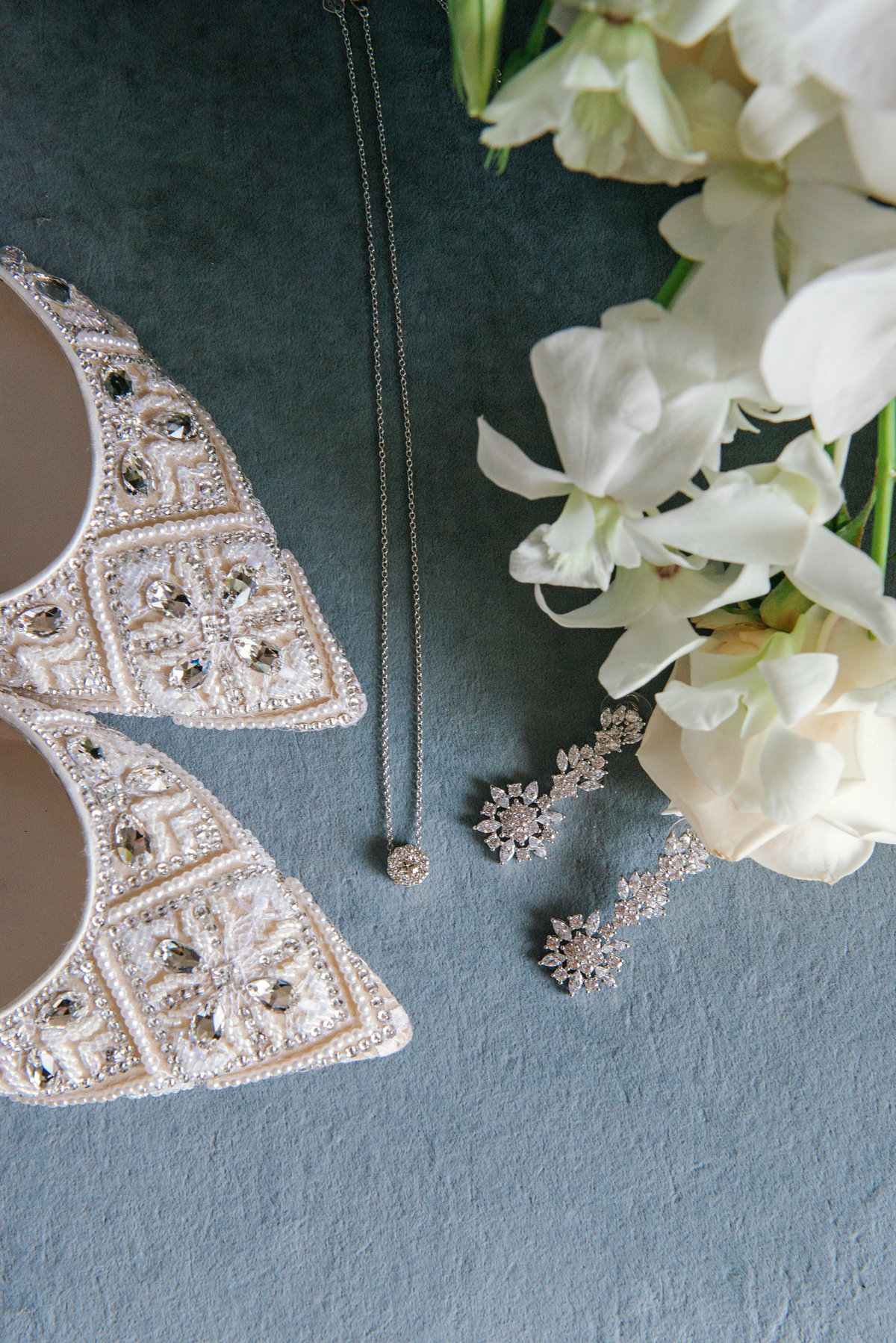 photo of bridal shoes and jewelry for wedding day at The Garden City Hotel