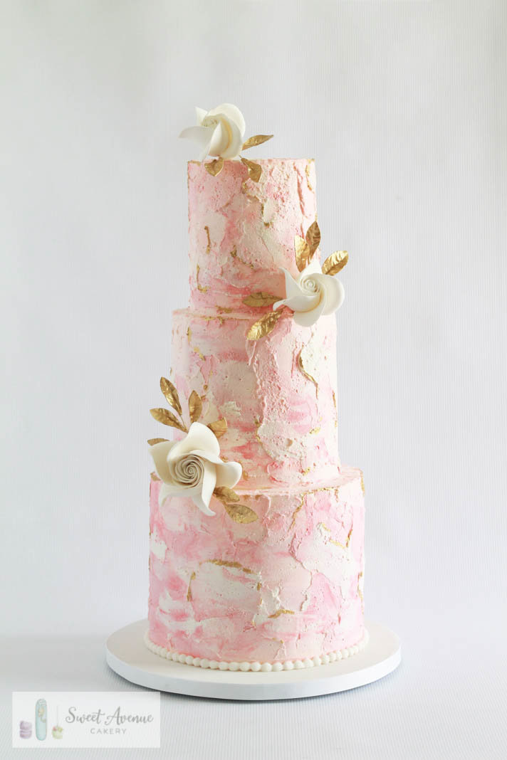 blush and white marble wedding cake with flowers and gold details, Hamilton ON wedding cakes