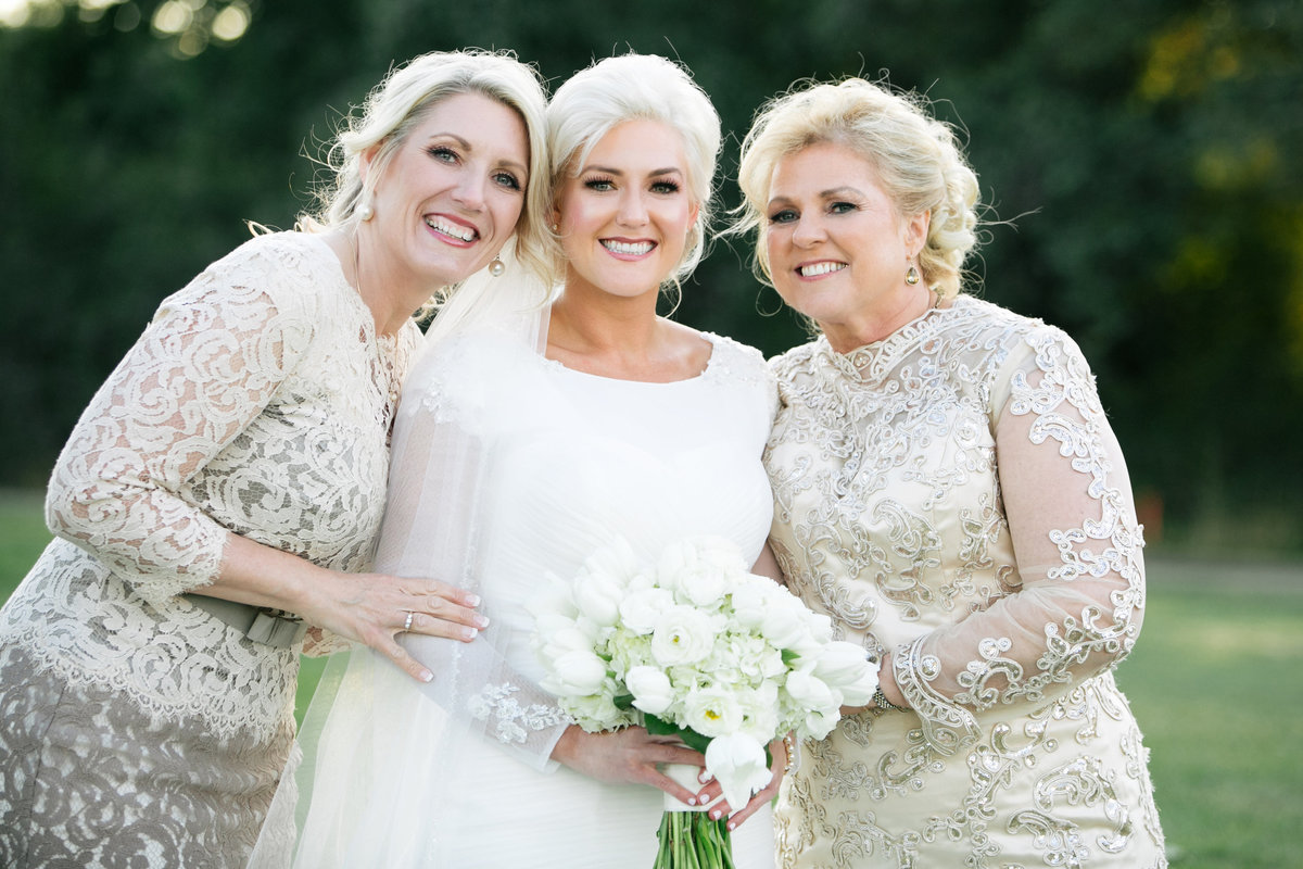 bride with mom and grandmother wedding photo