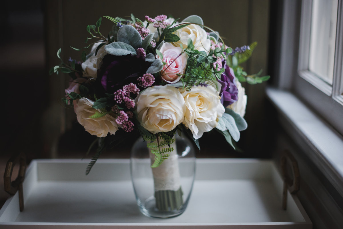 wedding bouquet by a window sill  in a vase