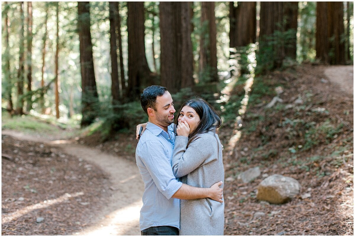 Boyfriend proposes amongst Big Sur redwood forest