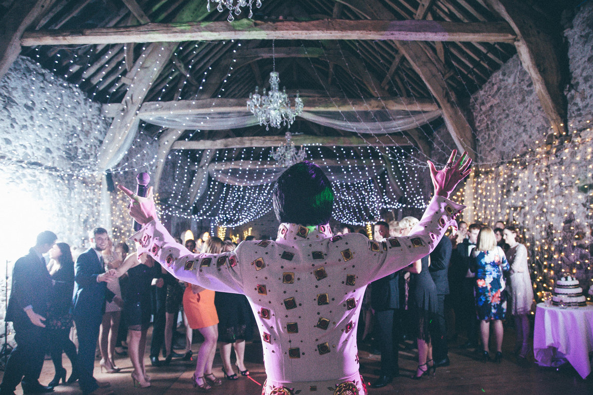 Elvis Impersonator at wedding reception at Parkhouse Barn - By Lake District Wedding Photographer Jono Symonds
