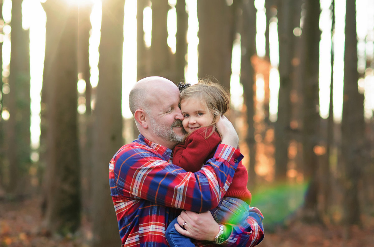 Portrait of a father and his daughter during family portraits taken at Nottoway Park in Northern Virginia by Sarah Alice Photography