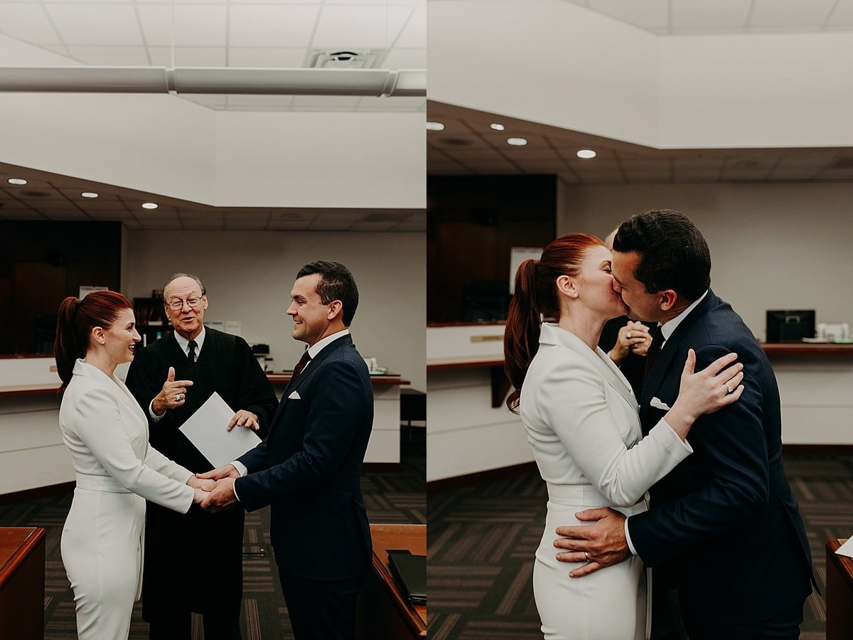 Bride and groom share their first kiss inside phoenix courtroom during wedding ceremony