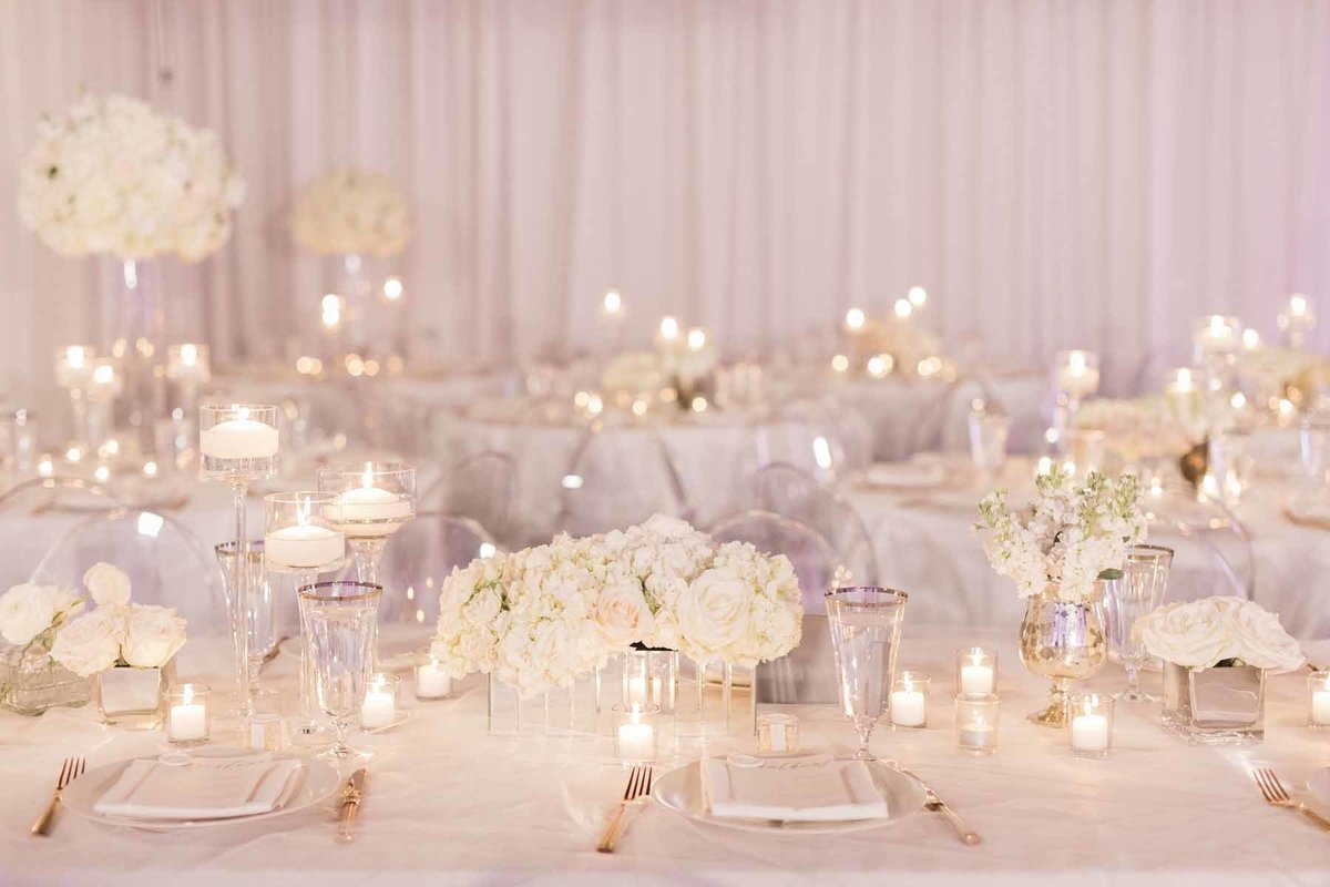 We designed all white clean flowers for this Canvas Event Space wedding filled with candlelit