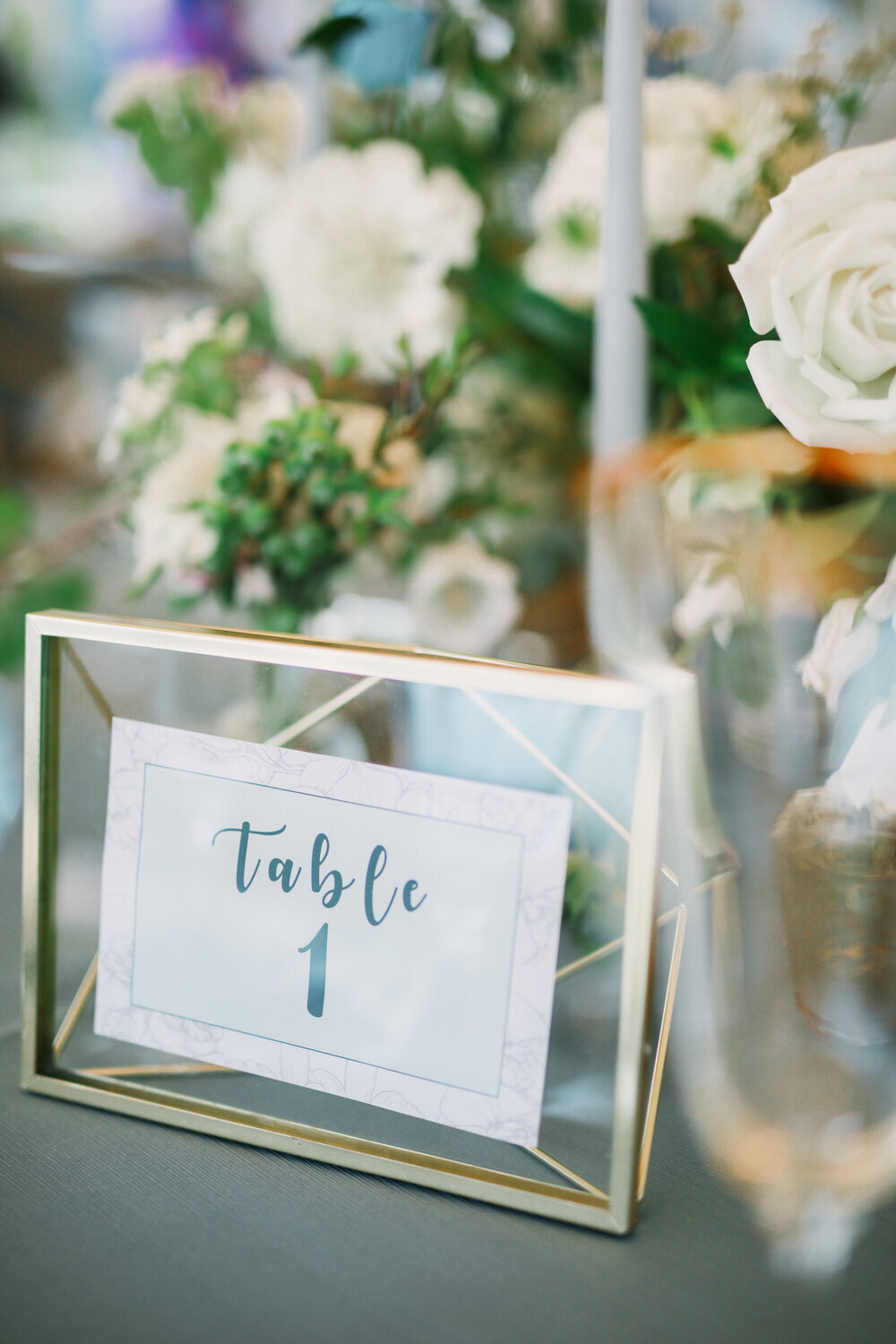 Kirkland-washington-wedding-planner-leigh-and-mitchell-waterfront-wedding-seattle-event-design-gold-framed-table-numbers