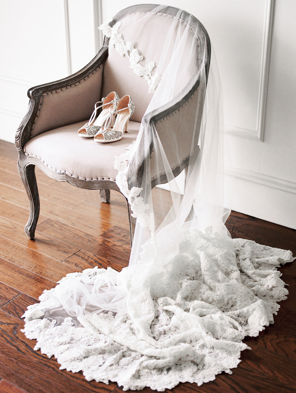 bridal shoes and veil in chair