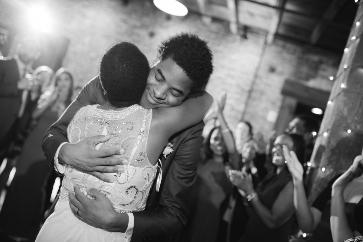Groom hugging his mom at the end of the mother-son dance at the Booking House