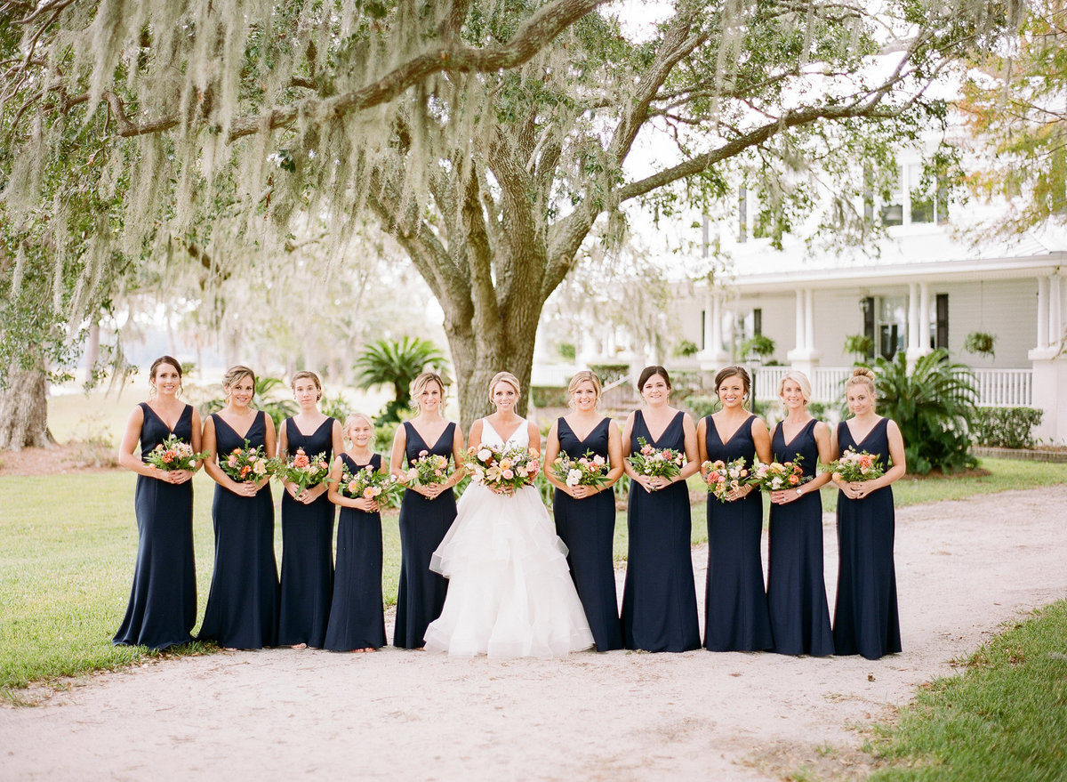 Bride and Bridesmaids in Classic Navy Blue Dresses Charleston Wedding
