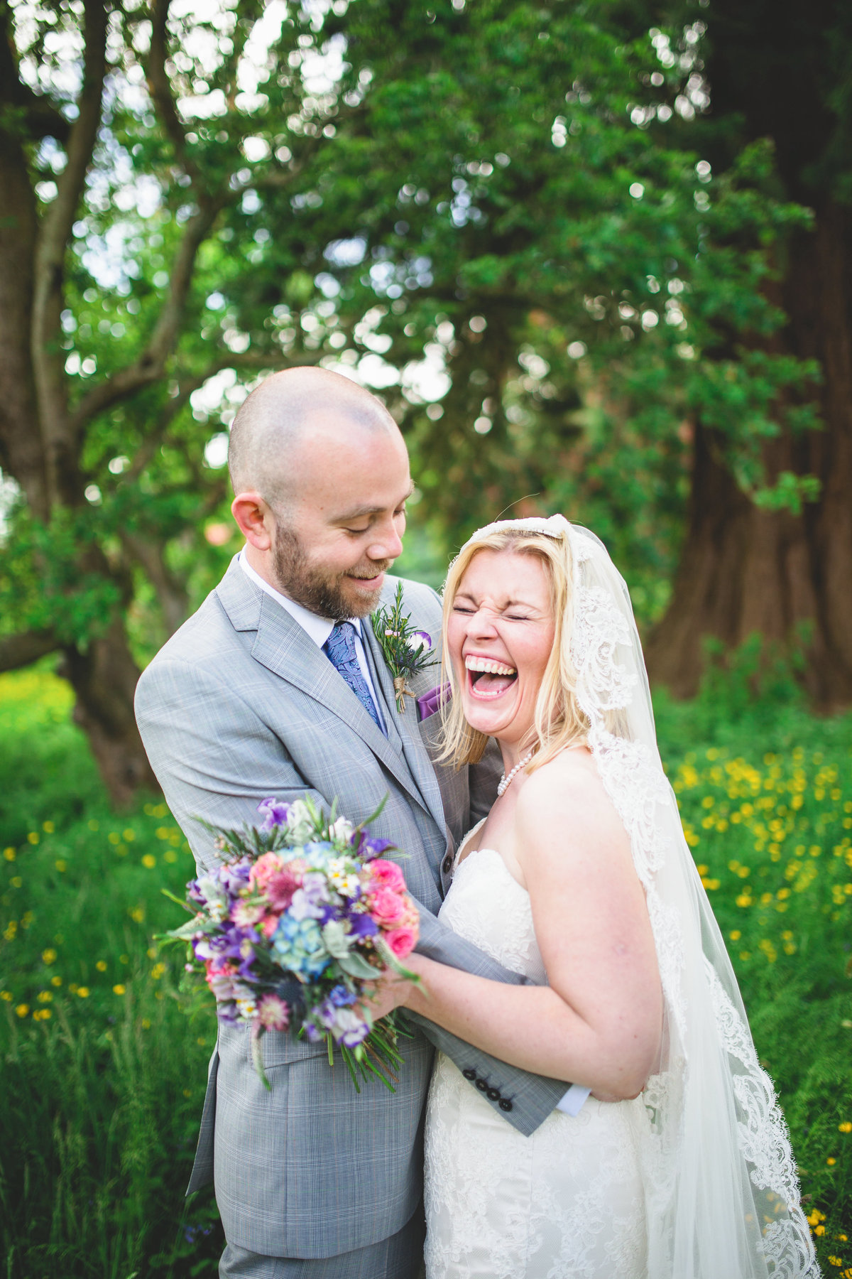 bride laughing in buttercups