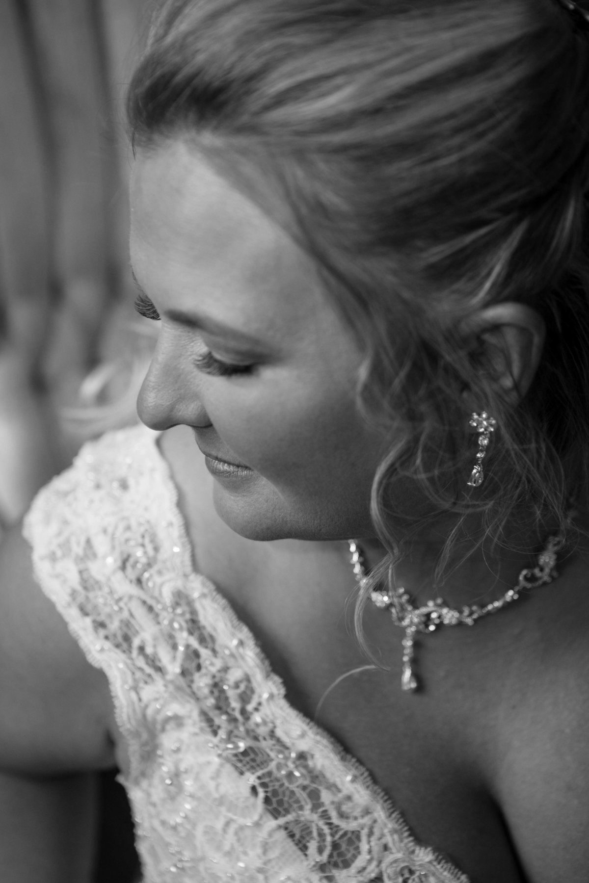 earrings and necklace on bride
