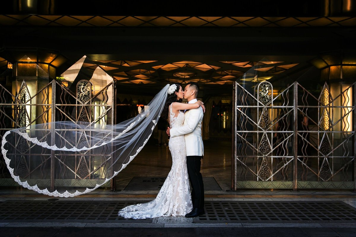 wedding couple kiss veil cicada restaurant in downtown los angeles