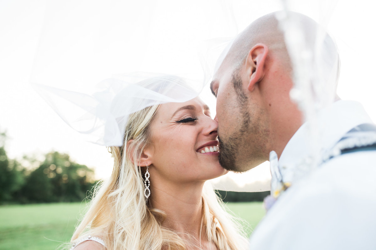 Bride and Groom Kissing by Grand Rapids Wedding PHotographer