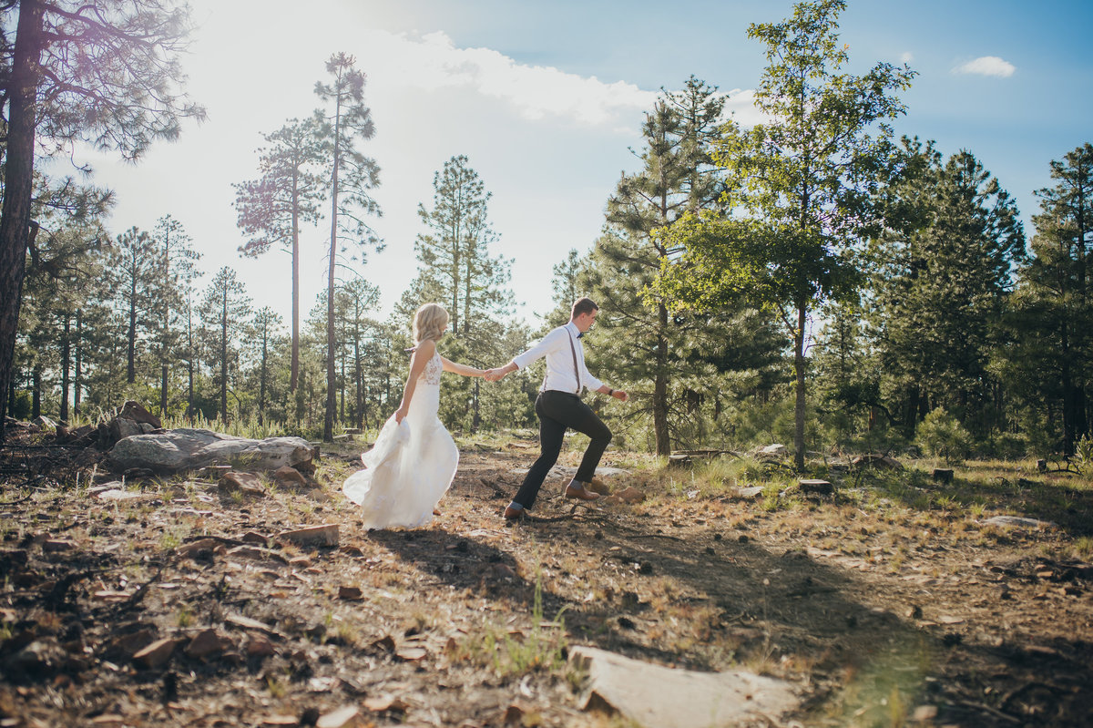 An adventurous couple funning across the forest in Pinetop, Arizona