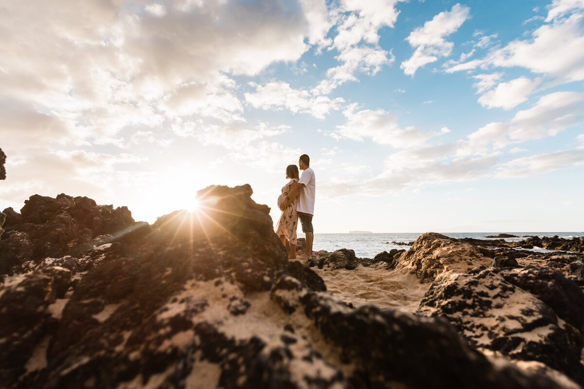 Couple at makena cove beach for a maternity photography session with moorea thill