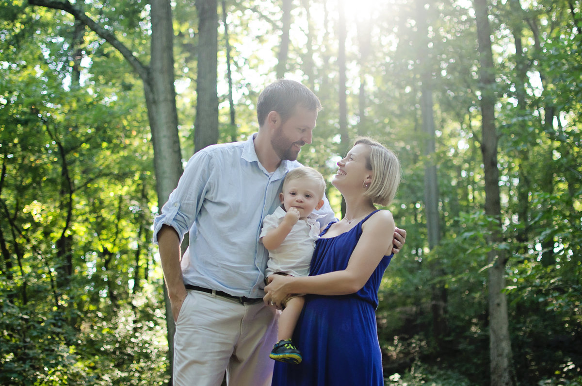 Portrait of a mom and Dad with their son taken at Lubber Run Park in Arlington, Virginia taken by Sarah Alice Photography
