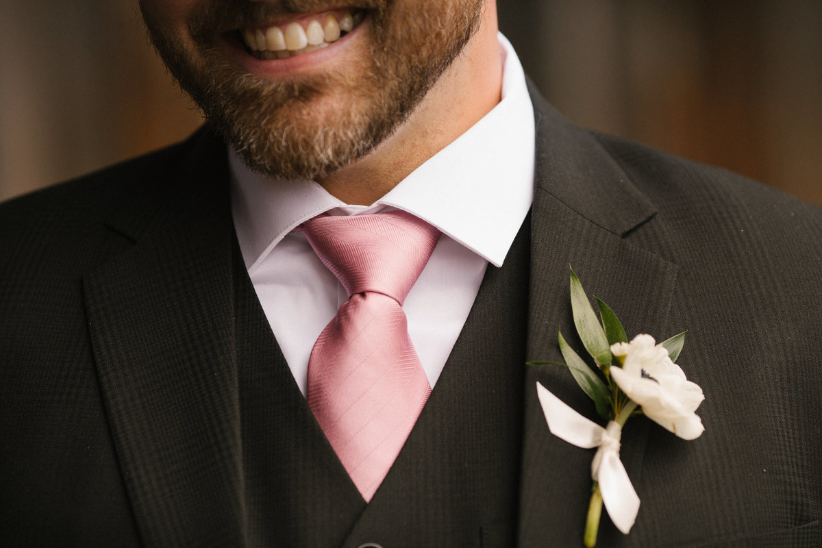 A man wearing a boutonniere.