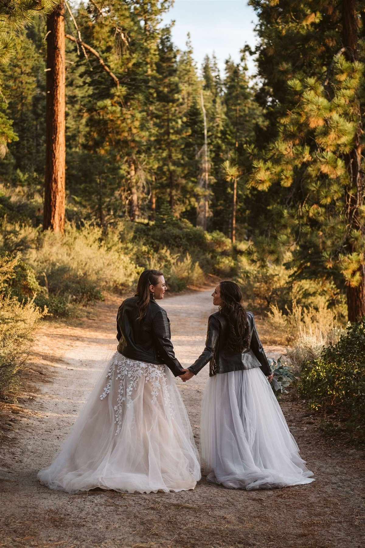 Two brides taking a stroll in the forest