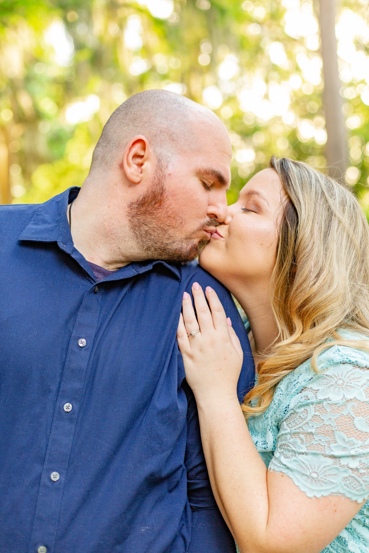 Couple shares kiss at their engagement session in Orlando, Florida