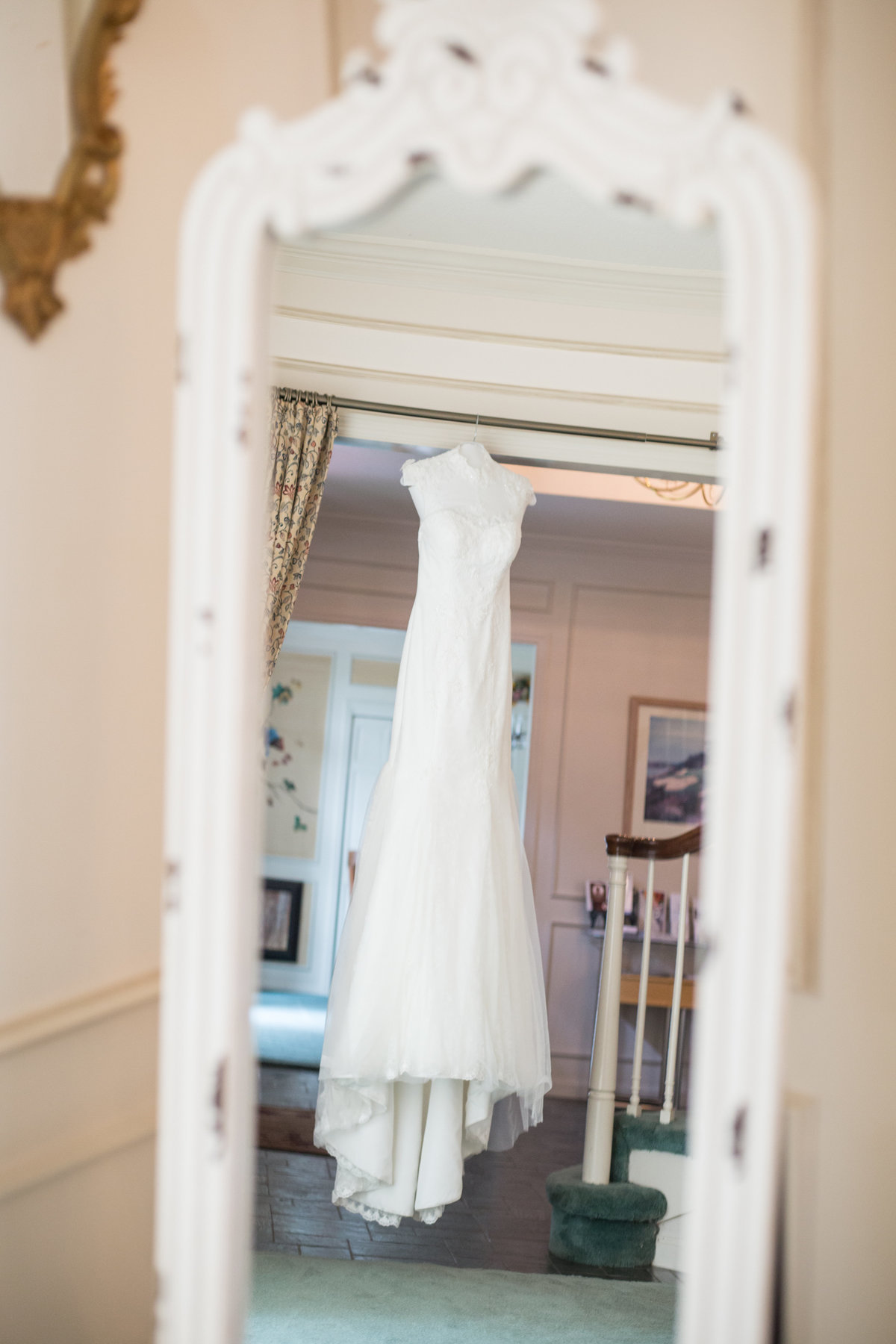 vintage inspired wedding dress hangs for photos at northern california wedding