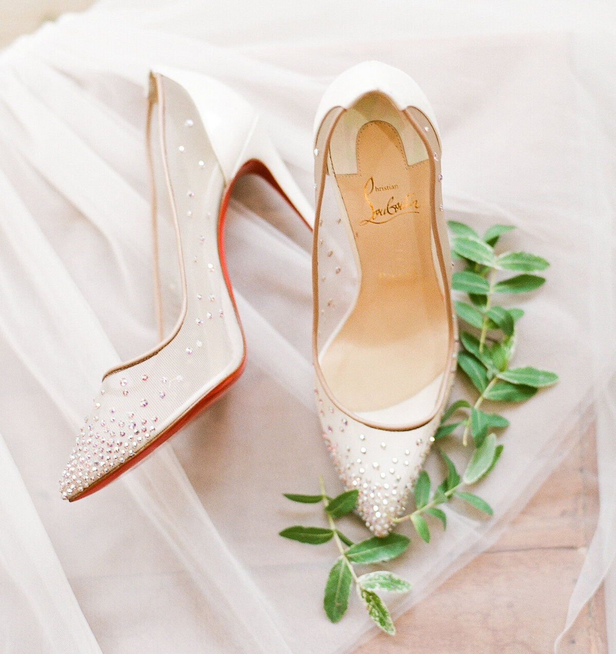 White Christian Louboutin bridal shoes