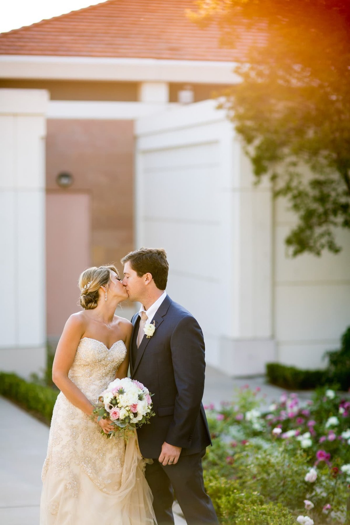 Bride and Groom share a kiss during their wedding shoot