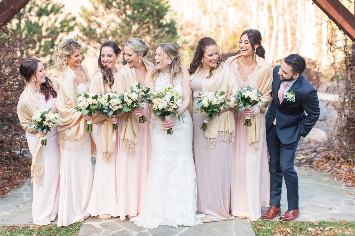 Bride and bridesmaids laughing at house mountain inn wedding