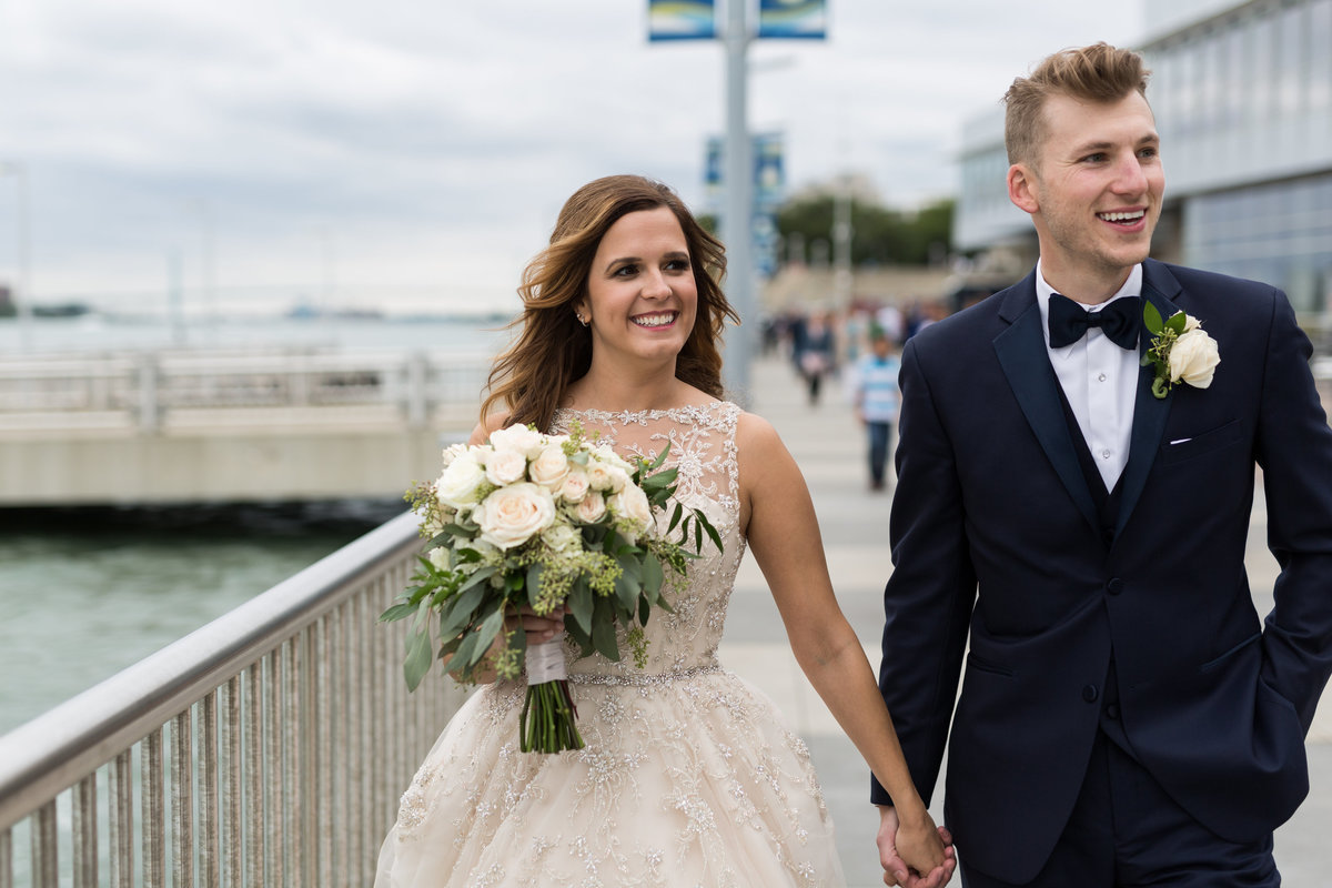 Bride and groom on Detroit riverfront at the Waterview loft