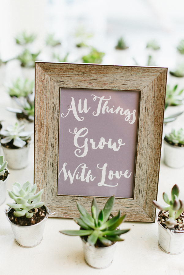 Succulent seating cards with all things grow with love sign