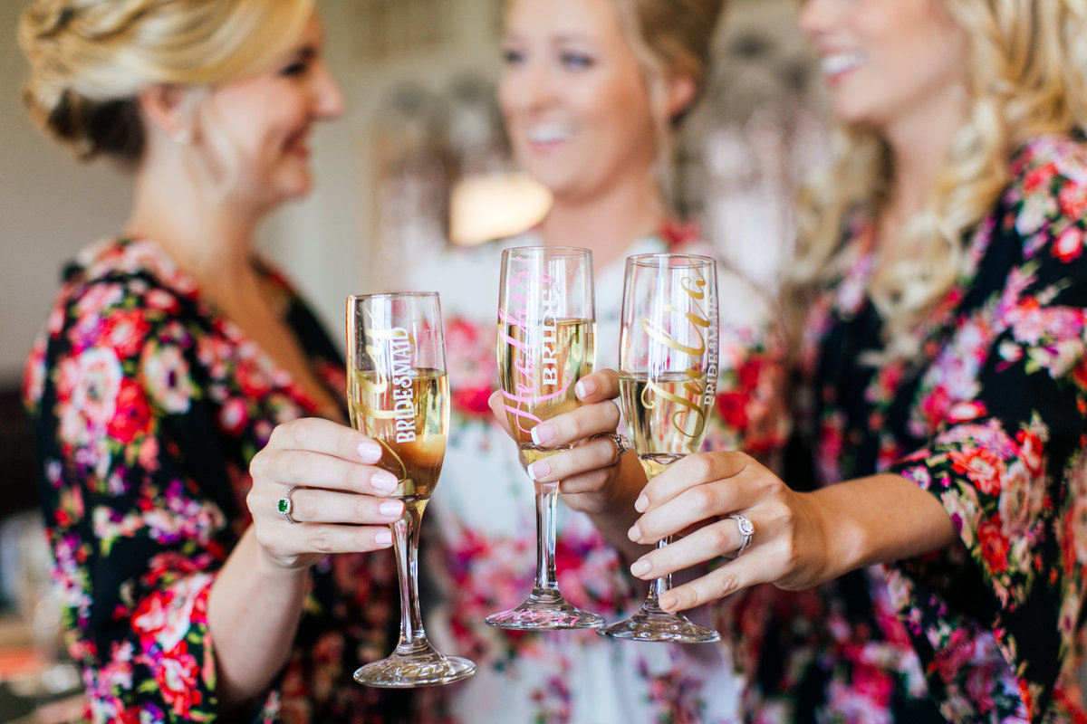 Baltimore-Wedding-Photographer-Bridesmaids-Cheersing-Champagne-Robes