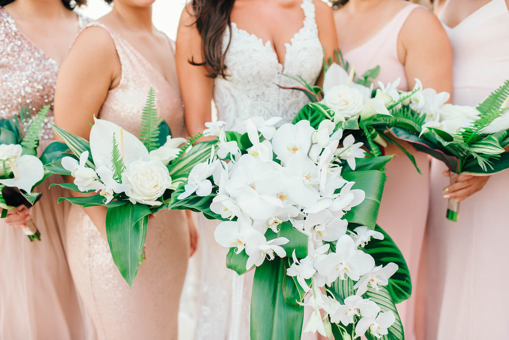 white & palm leave bouquets