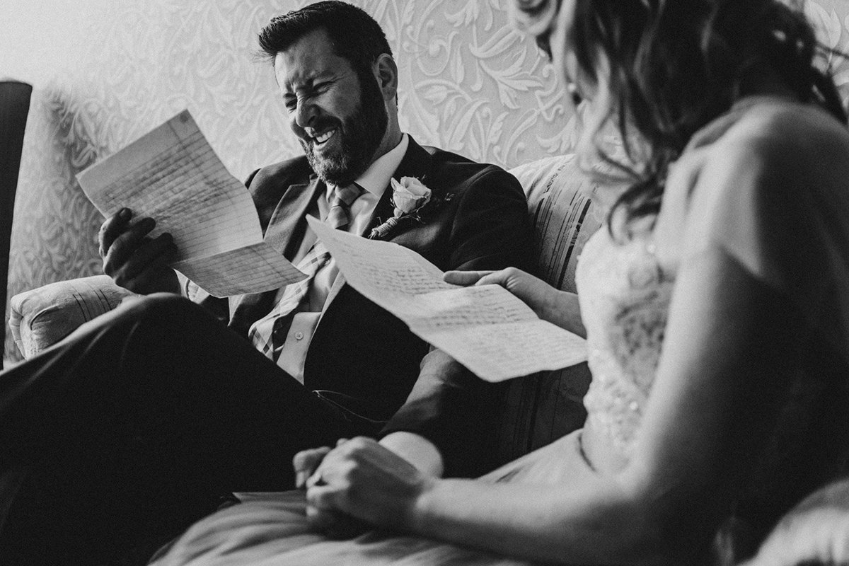 wedding couple reading letters in Denver Athletic Club in Denver Colorado