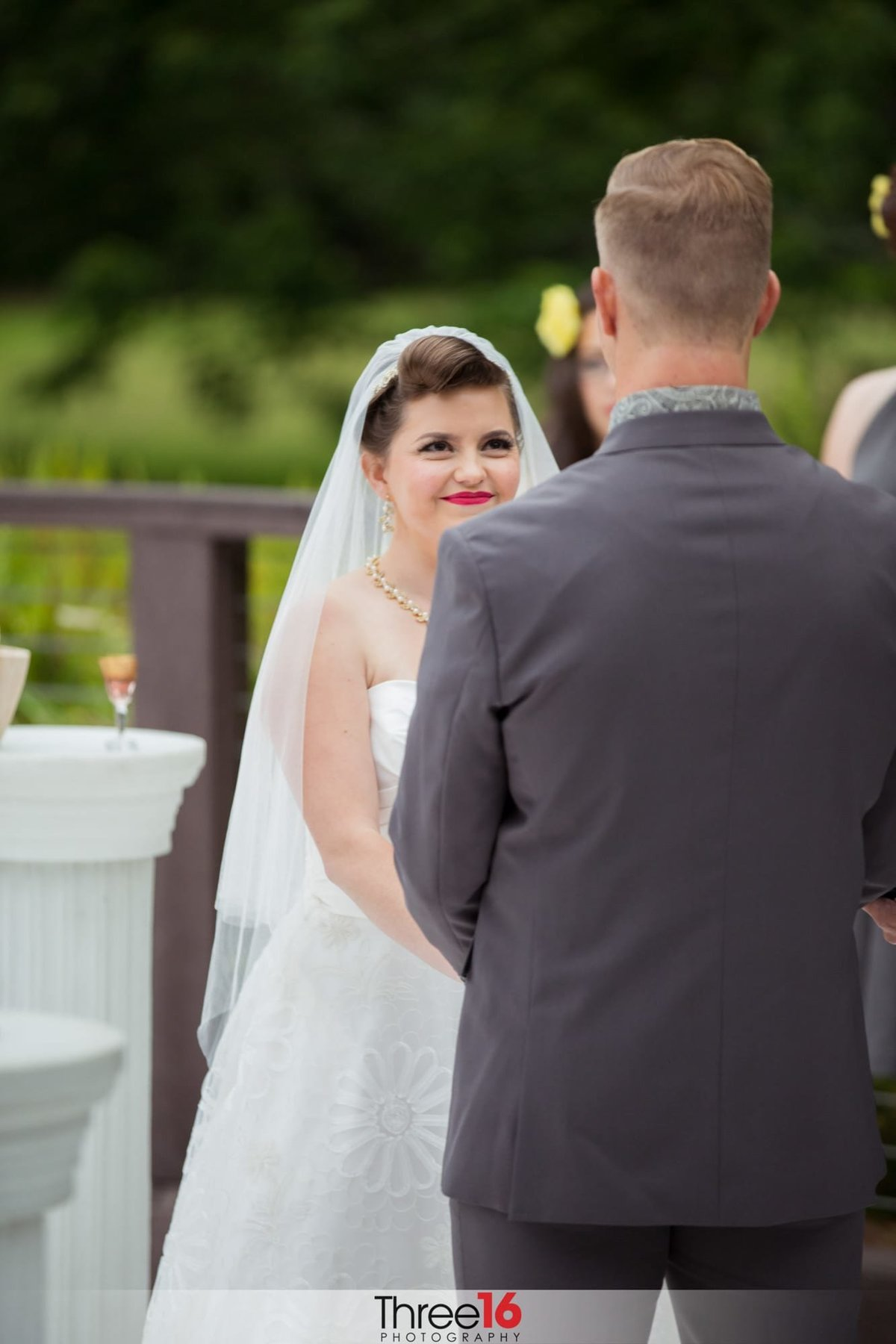 Bride stares at her Groom during the wedding ceremony